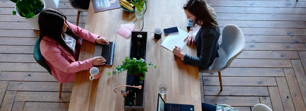 women coworkers at desk